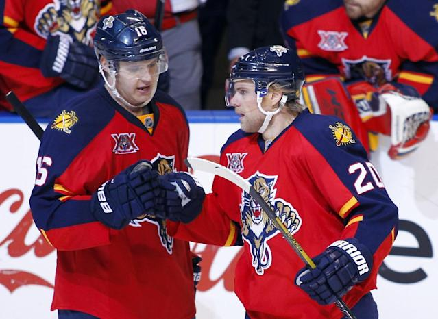 Florida Panthers left wing Sean Bergenheim (20) celebrates with teammate Aleksander Barkov (16) after scoring a goal during the third period of an NHL hockey game against the Montreal Canadiens in Sunrise, Fla., Sunday, Dec. 29, 2013. (AP Photo/Terry Renna)
