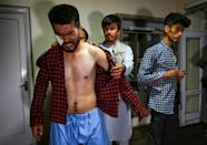 The men say they were punched and beaten with batons, electrical cables and whips after being accused of organising the protest (AFP/Wakil KOHSAR)