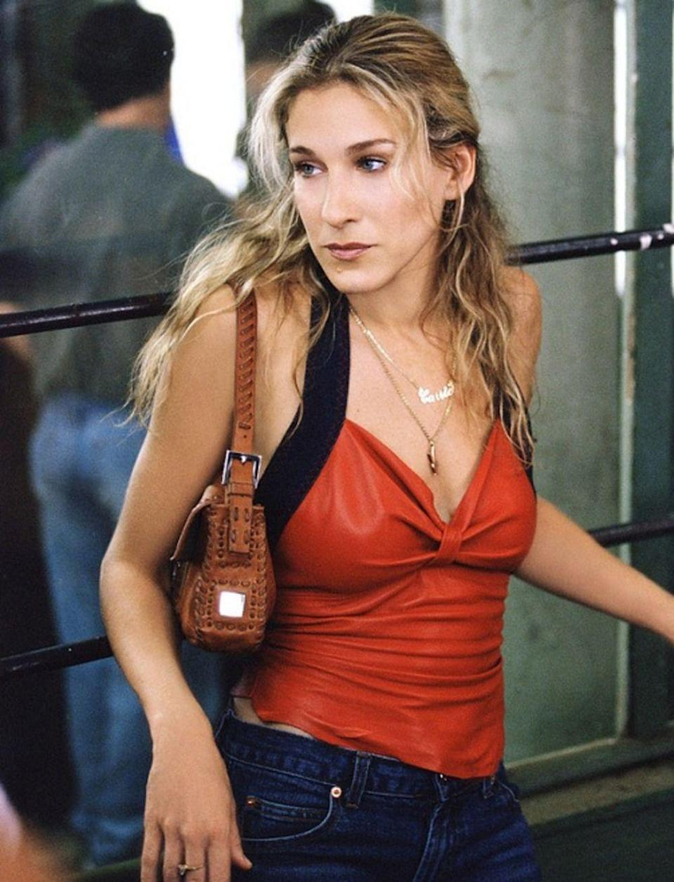 """<p>When <a href=""""https://www.youtube.com/watch?v=gl73_Agg7YY"""" rel=""""nofollow noopener"""" target=""""_blank"""" data-ylk=""""slk:Carrie Bradshaw got robbed in Season 3 of"""" class=""""link rapid-noclick-resp"""">Carrie Bradshaw got robbed in Season 3 of </a><em><a href=""""https://www.youtube.com/watch?v=gl73_Agg7YY"""" rel=""""nofollow noopener"""" target=""""_blank"""" data-ylk=""""slk:Sex and the City"""" class=""""link rapid-noclick-resp"""">Sex and the City</a> </em>and protested by saying, """"It's a baguette!"""", she helped immortalize the coveted bag. Although the episode aired in 2000, the design began building steam the year prior.</p>"""