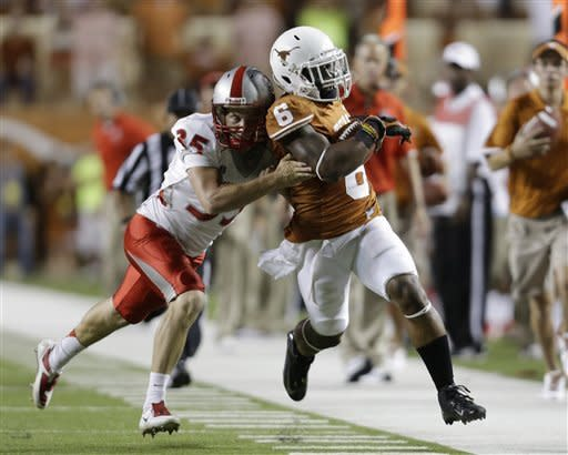 Texas' Quandre Diggs (6) is hit by New Mexico's Ben Skaer (35) on a punt-return during the second quarter of an NCAA college football game on Saturday, Sept. 8, 2012, in Austin, Texas. (AP Photo/Eric Gay)