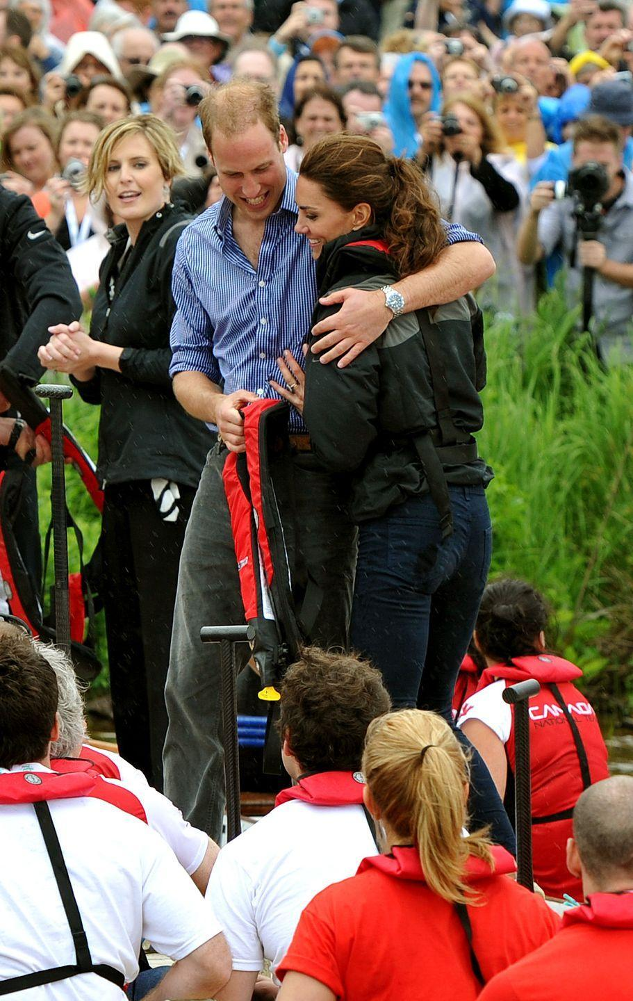 <p>Prince William sweetly snuggled Kate after the team he rowed in won a boat race, in which they competed against each other in Canada. This photo was taken during their first royal tour together in 2011 as newlyweds.</p>