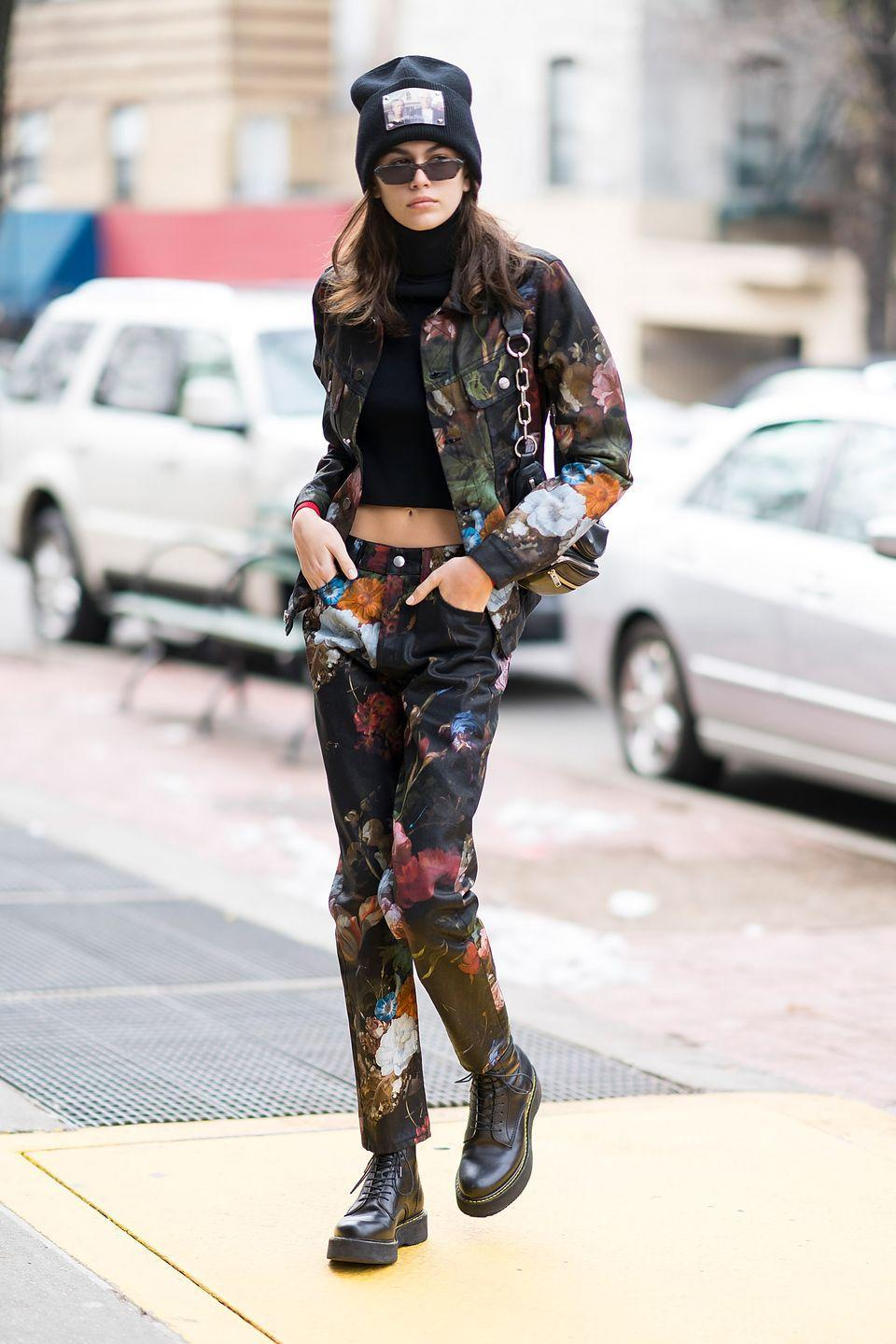 <p>The model wore a patching floral printed denim jacket and jeans for a day out in NYC. She accessorised the look with a pair of black lace-up boots and a beanie hat. </p>