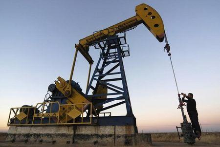 Oil prices climbed on Monday morning in Asia, recovering from steep drops last week.