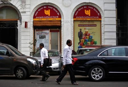 People walk past a Punjab National Bank branch in Mumbai