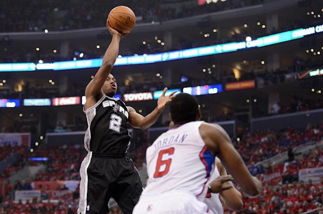 LOS ANGELES, CA - MAY 20: Kawhi Leonard #2 of the San Antonio Spurs shoots the ball over DeAndre Jordan #6 of the Los Angeles Clippers in the first quarter in Game Four of the Western Conference Semifinals in the 2012 NBA Playoffs on May 20, 2011 at Staples Center in Los Angeles, California. NOTE TO USER: User expressly acknowledges and agrees that, by downloading and or using this photograph, User is consenting to the terms and conditions of the Getty Images License Agreement. (Photo by Harry How/Getty Images)