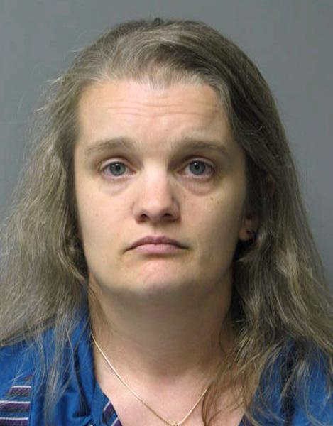 """Pauline L. Morse is seen in an undated photo provided by the Delaware State Police. Morse, 40, and her husband, Melvin Morse, a Georgetown pediatrician, were arrested Tuesday, Aug. 7, 2012 by Delaware State Police and charged with recklessly endangering their two daughters, including the use of a form of discipline that police say the man called """"waterboarding."""" Melvin Morse operates a pediatric practice in Milton, Del., and police say state medical regulators have been notified about the arrests. Police say Melvin Morse remains in custody, while Pauline Morse is out on bail. (AP Photo/Delaware State Police)"""