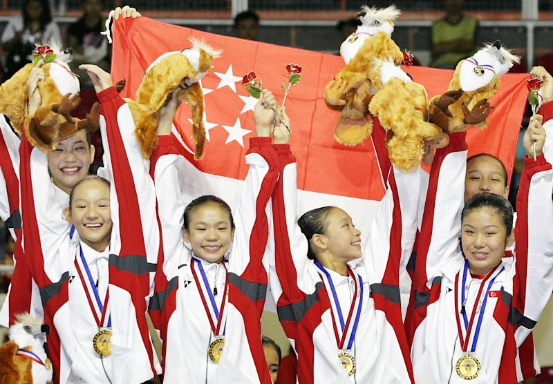 Members of Singapore's women gymnastic team, (L to R) Lee Wen Si, Lee Wen Ling, Tabitha Tay Jia Hui, Nicole Tay Xi Hui, Lim Heem Wei and Nur Atikah Nabilah, celebrate after winning the gold medal in the women's gymnastics team competition at the 23rd Southeast Asian Games in Manila on November 29, 2005. Singapore won the gold medal, while Vietnam took home the silver and Malaysia the bronze. REUTERS/Bazuki Muhammad