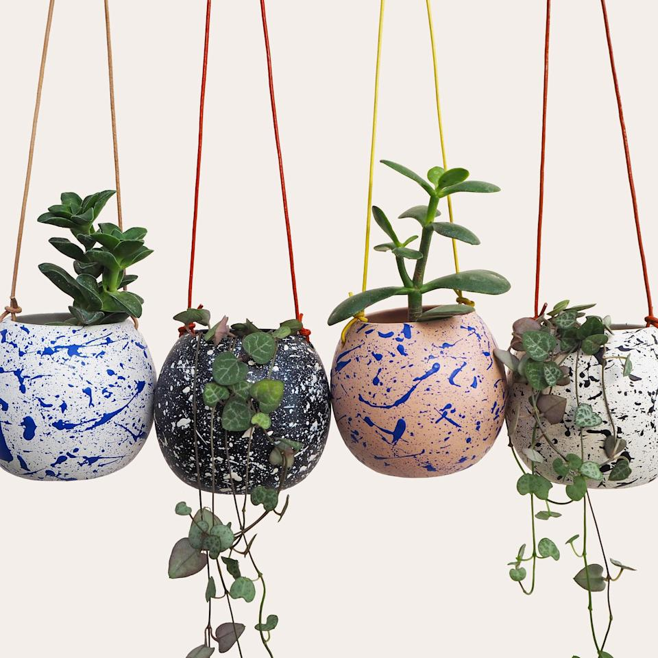 """<h2>Etsy Ceramic Splatter Hanging Planter</h2> <br>The hand-painted splatter on this ceramic pot makes for a subtle yet chic decorative accent in any room.<br><br><strong>HelloMariluStudio</strong> Hand-painted Ceramic Splatter Round Hanging Planter, $, available at <a href=""""https://www.etsy.com/listing/783731185/hand-painted-ceramic-splatter-round"""" rel=""""nofollow noopener"""" target=""""_blank"""" data-ylk=""""slk:Etsy"""" class=""""link rapid-noclick-resp"""">Etsy</a><br>"""
