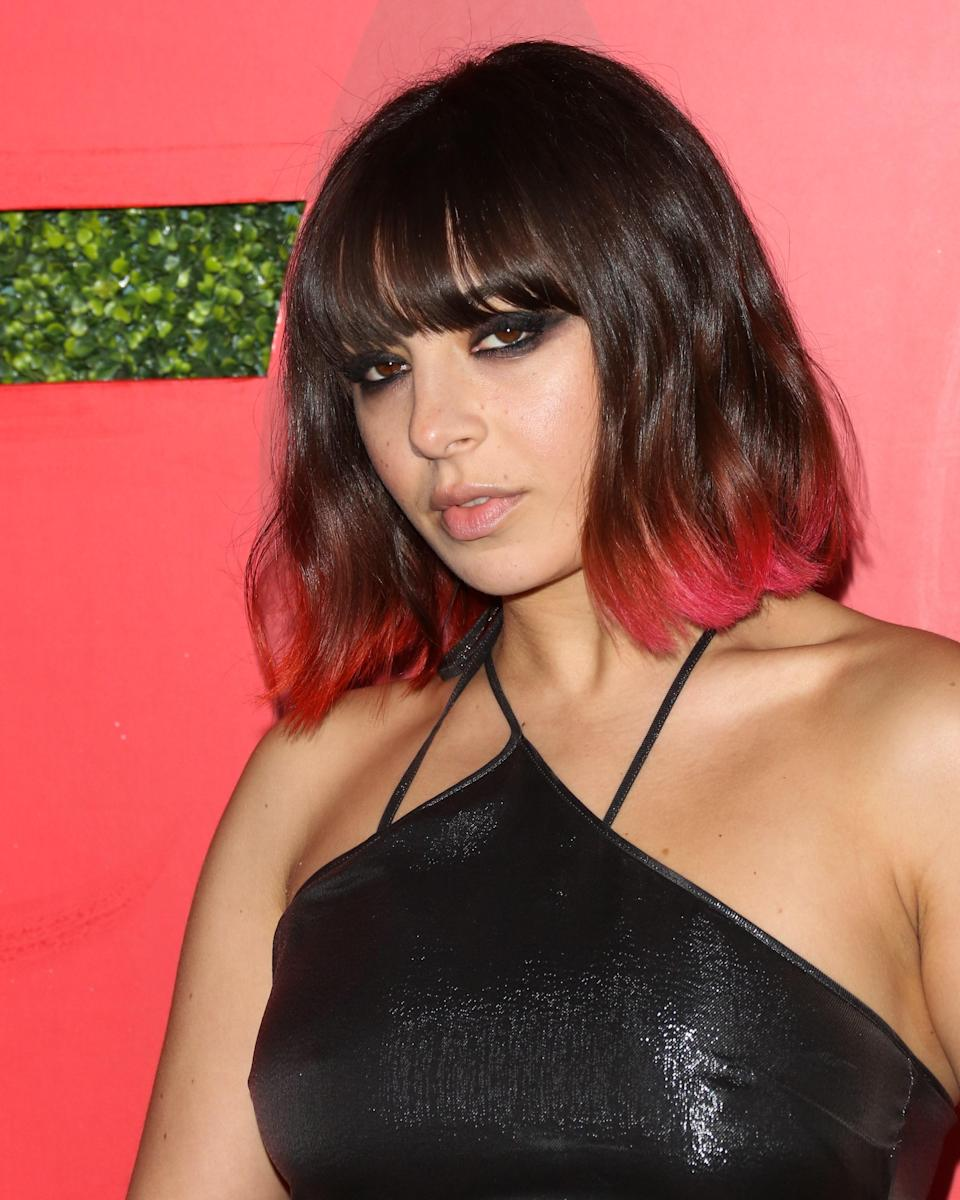 The easiest way to edge up a lob? Add some neon tips and blunt bangs, like Charli XCX.