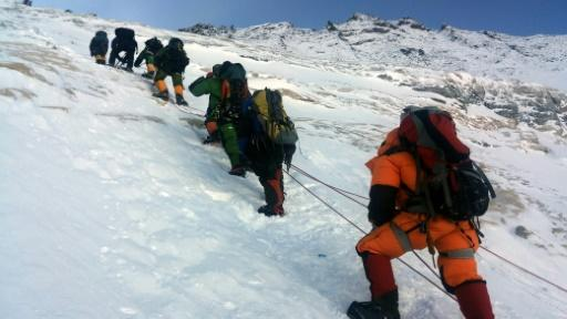 Mountaineers walk from Camp 3 to Camp 4 as they push for the summit of Mount Everest