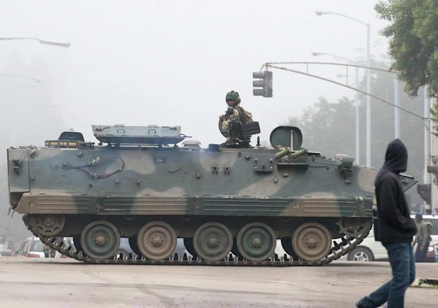 <p>Military vehicles and soldiers patrol the streets in Harare, Zimbabwe, Nov. 15, 2017. (Photo: Philimon Bulawayo/Reuters) </p>