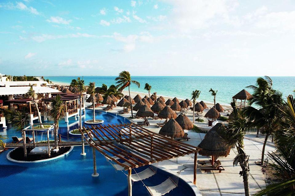 """<p><strong><a href=""""http://www.excellenceresorts.com/resorts/excellence-playa-mujeres/"""" rel=""""nofollow noopener"""" target=""""_blank"""" data-ylk=""""slk:Excellence Playa Mujeres, Isla Mujeres, Mexico"""" class=""""link rapid-noclick-resp"""">Excellence Playa Mujeres, Isla Mujeres, Mexico</a></strong><br>You'll never run out of things to do at this adults-only retreat, which offers an array of water sports, including sailing, scuba diving, sea kayaking, and paddle boarding in its honeymoon package. To take things to the next level, you'll also find rose petals spread across the bed upon checking into your room.</p><span class=""""copyright"""">Photo: Courtesy of Excellence.</span>"""