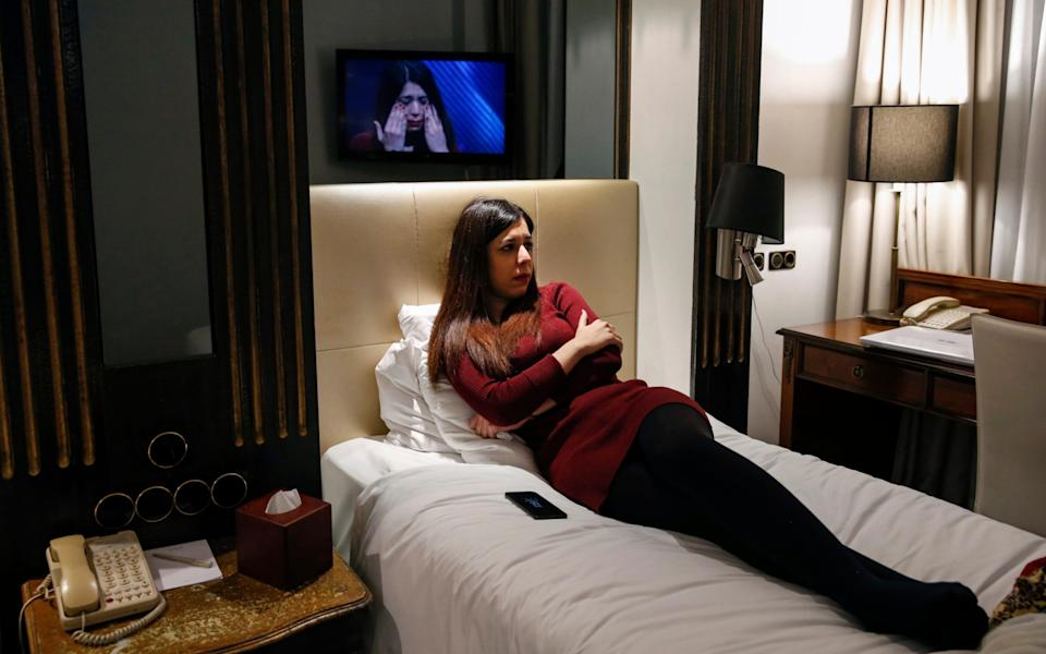 Shohreh Bayat watches her first television interview on BBC Newsnight at a hotel in London - Hollie Adams/Getty Images