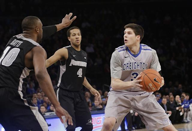 Creighton's Doug McDermott (3) protects the ball from Providence's Kadeem Batts (10) during the first half of an NCAA college basketball game in the finals of the Big East Conference tournament Saturday, March 15, 2014, at Madison Square Garden in New York. (AP Photo/Frank Franklin II)