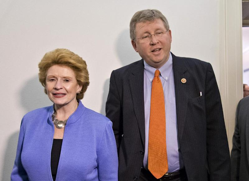 FILE - This Dec. 4, 2013 file photo shows Senate Agriculture Committee Chair Sen. Debbie Stabenow, D-Mich., left, and House Agriculture Committee Chairman Rep. Frank Lucas, R-Okla. on Capitol Hill in Washington. Farm-state lawmakers are pushing for final passage of the massive, five-year farm bill as it heads to the House floor Wednesday — member by member, vote by vote. There are goodies scattered through the bill for members from all regions of the country: a boost in money for crop insurance popular in the Midwest; higher cotton and rice subsidies for Southern farmers; renewal of federal land payments for Western states. There are cuts to the food stamp program — $800 million a year, or around 1 percent — for Republicans who say the program is spending too much money, but they are low enough that some Democrats will support them. (AP Photo/J. Scott Applewhite, File)