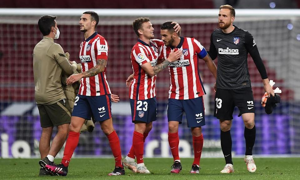 Kieran Trippier (centre) and Koke embrace at the final whistle.