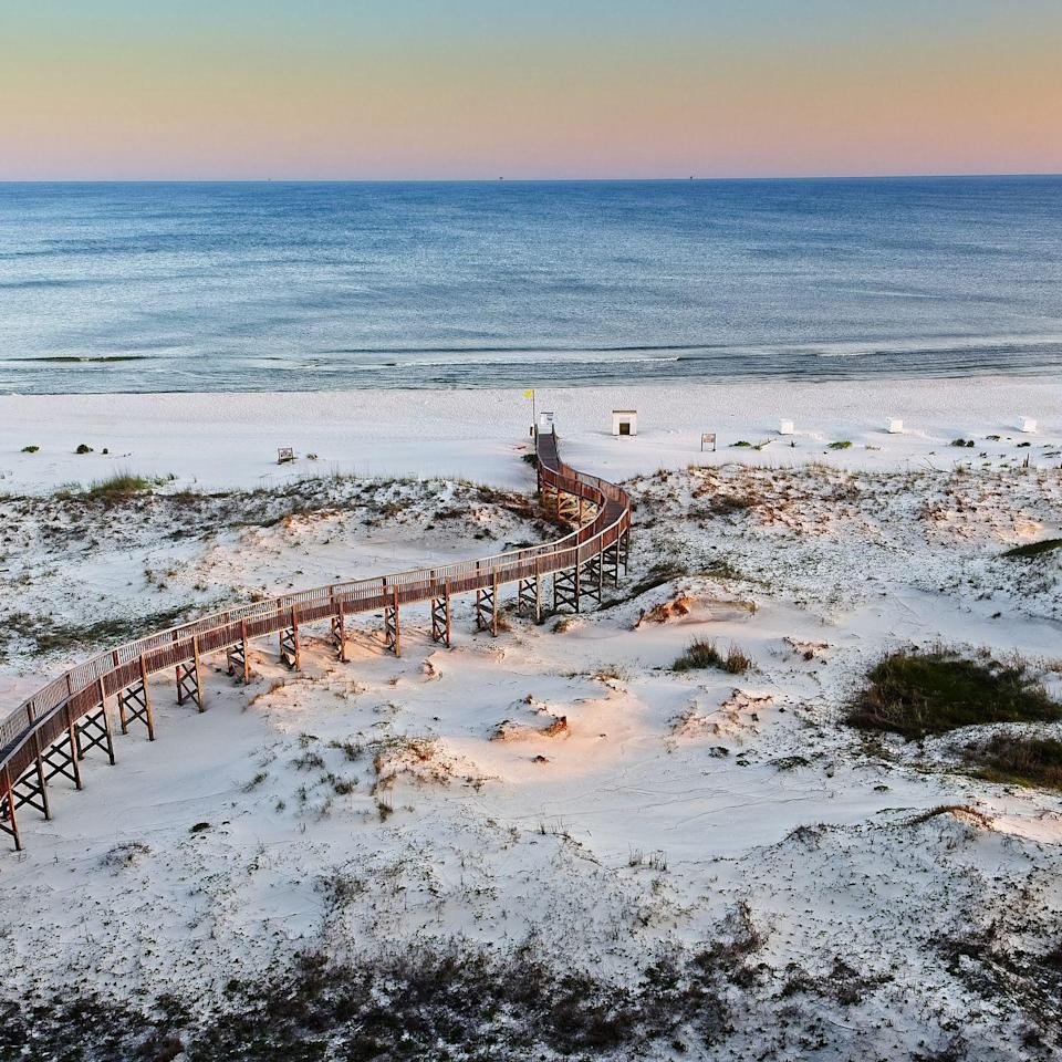 <p>The walkway to the beaches of Gulf Shores in Alabama, which also has trails, a pier and zip line over the dunes. </p>