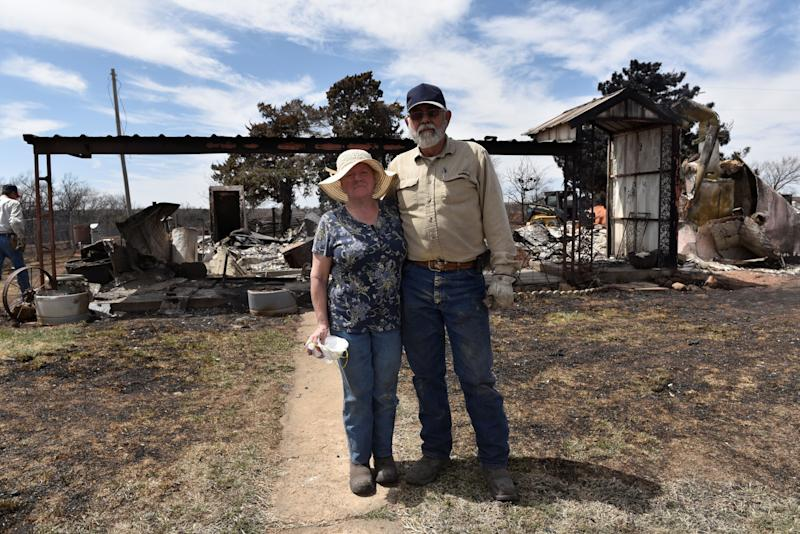 Arlinda and Larry Lynes stand in front of what remains of their home that was destroyed by the Rhea Fire near Taloga, Oklahoma, on. April 17.