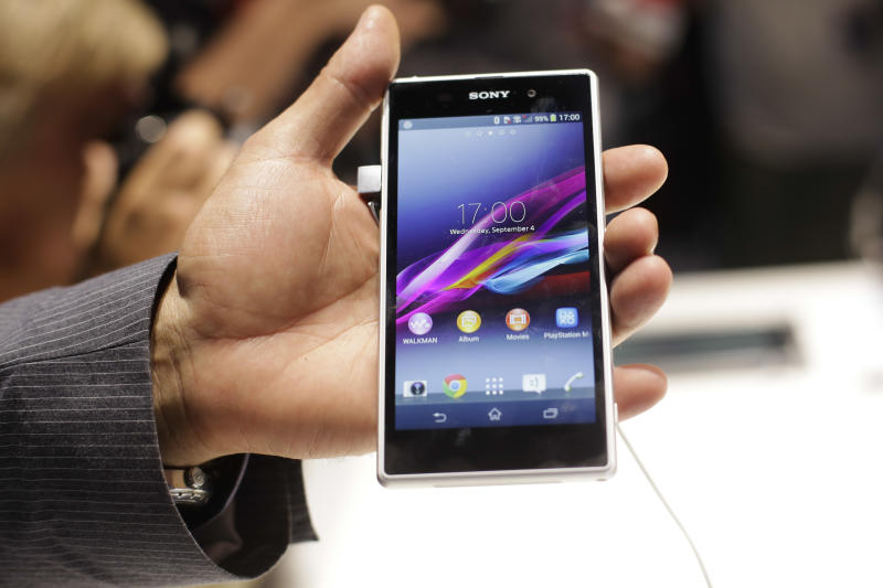 A man shows the new Sony Xperia Z1 smartphone at a Sony event ahead of the IFA, one of the world's largest trade fairs for consumer electronics and electrical home appliances in Berlin, Wednesday, Sept. 4, 2013. IFA will take place on the Berlin Exhibition Grounds from Sept 6 to 11, 2013. (AP Photo/Markus Schreiber)