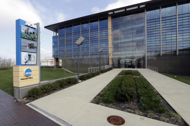 FILE - This is an April 25, 2018, file photo showing NCAA headquarters in Indianapolis. The NCAA wants a level playing field for all athletes, even if state law proposals threaten its longtime model for amateur sports. With the California assembly considering a potentially landmark measure that would allow athletes at state colleges and universities to profit from the use of their names, likenesses and images, an NCAA working group is trying to figure out how to respond. (AP Photo/Darron Cummings, File)