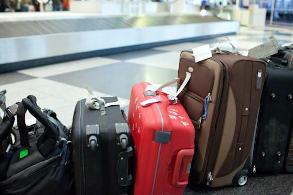 luggage lined up at the baggage claime in an airport