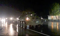 This photo made from the footage provided by Russian Defense Ministry press service on Thursday, Nov. 12, 2020, shows Russian military vehicles enter Stepanakert, the separatist region of Nagorno-Karabakh. Dozens of Russian peacekeepers destined for Nagorno-Karabakh have begun deploying hours after Armenia and Azerbaijan agreed to halt fighting over the separatist region. (Russian Defense Ministry Press Service via AP)