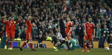 Football Soccer - Republic of Ireland v Wales - 2018 World Cup Qualifying European Zone - Group D - Aviva Stadium, Dublin, Republic of Ireland - 24/3/17 Wales' Neil Taylor is sent off by referee Nicola Rizzoli Action Images via Reuters / Matthew Childs Livepic