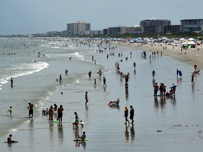 People celebrate Independence Day by visiting the beach on July 4, 2020 in Cocoa Beach, Florida. Crowds at the beach were below normal for a holiday weekend due to the coronavirus pandemic and a spike in COVID-19 cases in Florida.