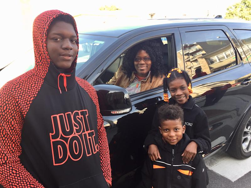 Lakeisha Alexander, 40, stops by Joplin Elementary School with her kids, Demetrius, 13, Amaria, 9, and Ke-Shawn, 5 in Chicago on Oct. 22, 2019.