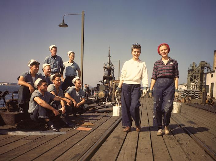 In 1943, sailors admire women workers at the Electric Boat Co. in New London, Conn., where submarines were built during World War II. (Photo: Bernard Hoffman/Getty Images)