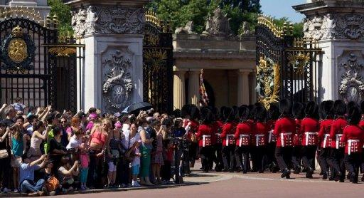 <p>Guardsmen march past onlookers into Buckingham Palace during the Changing of the Guard in London in July 23, 2012. The decision to publish photos of Prince William's wife Catherine topless has incensed the royal family, whose lawyers have obtained a civil injunction and sought criminal charges in Paris in a bid to curb their spreading.</p>