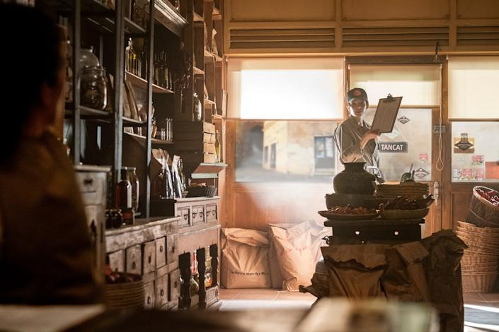 "<div class=""caption""> An elaborate spice shop designed with old wooden trestle shelving on a London soundstage sets the scene for confrontation. </div> <cite class=""credit"">Photo: Nick Wall/BBCA</cite>"