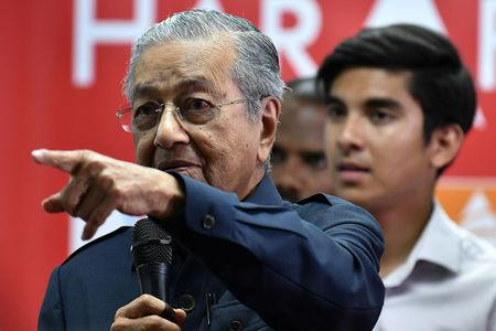 Malaysia's Mahathir says he will remain leader for 1-2 years