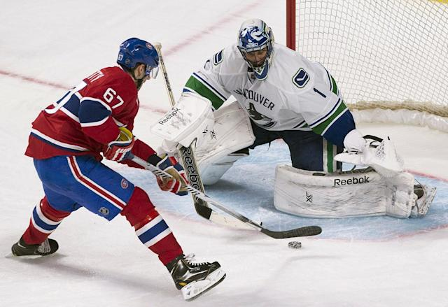 Vancouver Canucks goaltender Roberto Luongo stops a penalty shot by Montreal Canadiens' Max Pacioretty during the second period of an NHL hockey game Thursday, Feb. 6, 2014, in Montreal. (AP Photo/The Canadian Press, Graham Hughes)