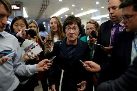 FILE PHOTO: Sen. Susan Collins (R-ME) speaks with reporters ahead of the party luncheons on Capitol Hill in Washington
