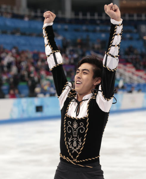 Michael Christian Martinez of the Philippines gestures as he leaves the ice after the men's short program figure skating competition at the Iceberg Skating Palace during the 2014 Winter Olympics, Thursday, Feb. 13, 2014, in Sochi, Russia. (AP Photo/Ivan Sekretarev)