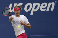 Alexander Zverev, of Germany, returns a shot to Borna Coric, of Croatia, during the quarterfinals of the US Open tennis championships, Tuesday, Sept. 8, 2020, in New York. (AP Photo/Seth Wenig)