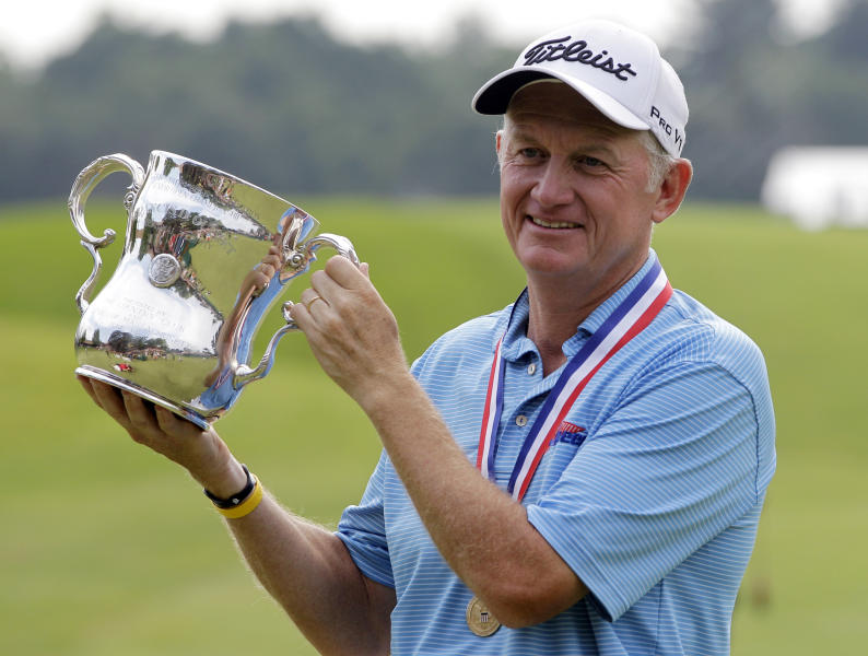 Roger Chapman holds the Francis D. Ouimet Memorial Senior Open Championship Trophy after winning the U.S. Senior Open at the Indianwood Golf and Country Club in Lake Orion, Mich., Sunday, July 15, 2012. (AP Photo/Carlos Osorio)