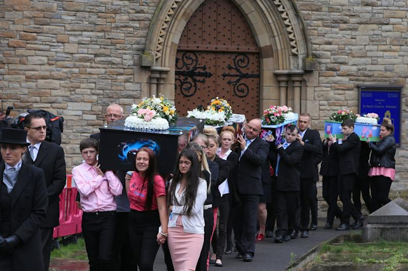 The coffins of Demi, Brandon, Lacie and Lia Pearson, who were killed in a petrol bomb attack at their home last year: PA