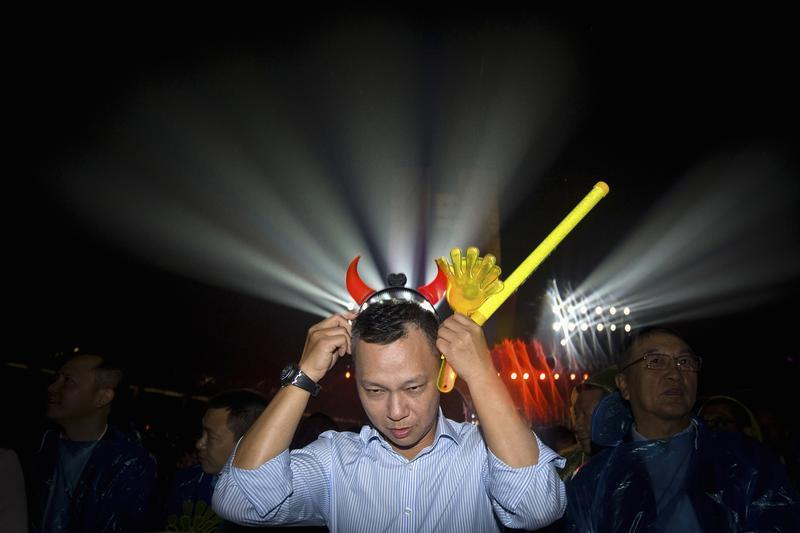 Lu, new chief executive of Alibaba Group, puts on headband during celebration of 10th anniversary of Taobao Marketplace in Hangzhou