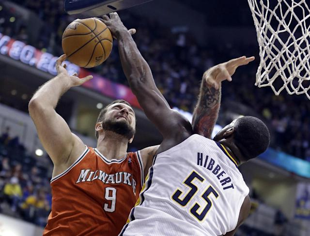 Indiana Pacers center Roy Hibbert, right, blocks the shot of Milwaukee Bucks center Miroslav Raduljica during the first half of an NBA basketball game in Indianapolis, Friday, Nov. 15, 2013. (AP Photo/Michael Conroy)