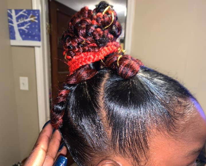 Parents of 8-year-old barred from school photos because of 'extreme hairstyle': 'Race has everything to do with this'