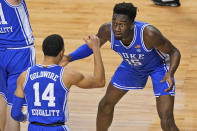 Duke guard Jordan Goldwire (14) celebrates with teammate center Mark Williams (15) during the first half of an NCAA college basketball game against Louisville in the second round of the Atlantic Coast Conference tournament in Greensboro, N.C., Wednesday, March 10, 2021. (AP Photo/Gerry Broome)
