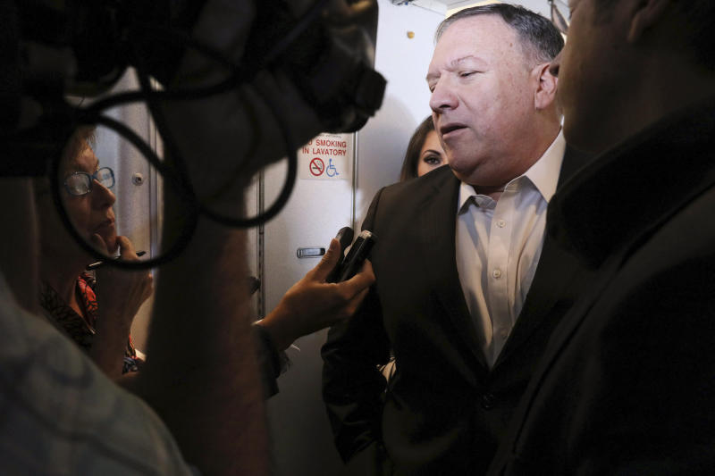 U.S. Secretary of State Mike Pompeo speaks with reporters aboard his plane en route to Thailand, before taking off from Andrews Air Force Base, Md., Tuesday, July 30, 2019. (Jonathan Ernst/Pool Photo via AP)
