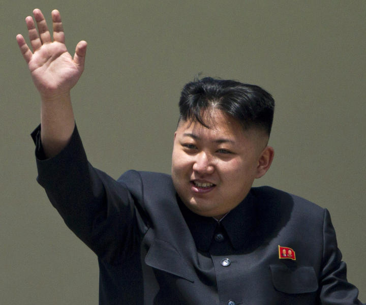 """FILE - In this Sunday, April 15, 2012 file photo, North Korean leader Kim Jong Un waves from a balcony at the end of a mass military parade in Pyongyang's Kim Il Sung Square. The online version of China's Communist Party newspaper has hailed a report by The Onion naming Kim as the """"Sexiest Man Alive"""" - not realizing it is satire. The People's Daily on Tuesday, Nov. 27, 2012 ran a 55-page photo spread on its website in a tribute to the round-faced leader, under the headline """"North Korea's top leader named The Onion's Sexiest Man Alive for 2012."""" (AP Photo/David Guttenfelder, File)"""