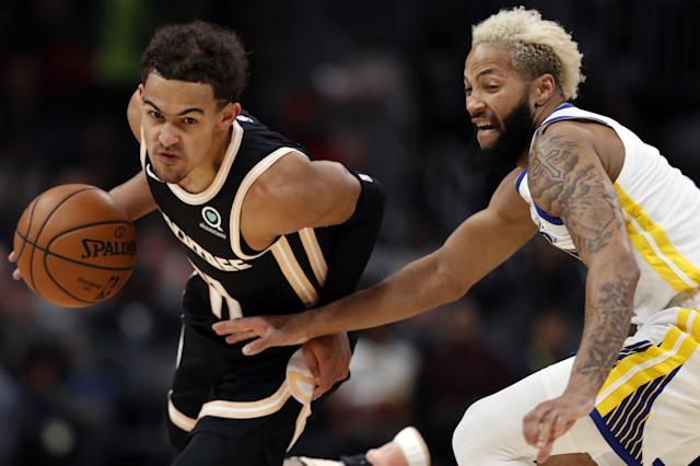 Atlanta Hawks guard Trae Young (11) works against the Golden State Warriors Ky Bowman in the first half of an NBA basketball game Monday, Dec. 2, 2019, in Atlanta. (AP Photo/John Bazemore)