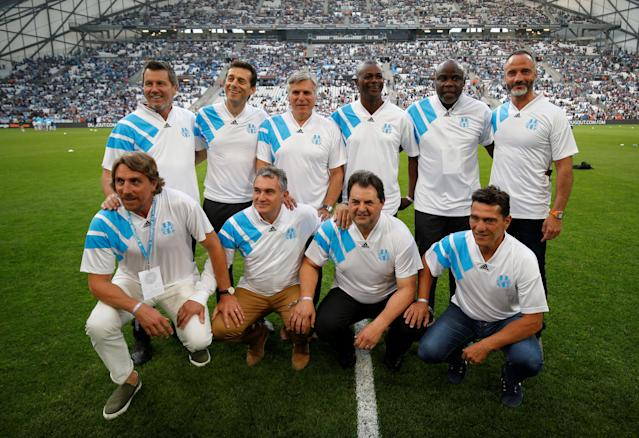 Soccer Football - Ligue 1 - Olympique de Marseille vs Amiens SC - Orange Velodrome, Marseille, France - May 19, 2018 Marseille's 1993 Champions League winning team pose for a photo before the match REUTERS/Philippe Laurenson
