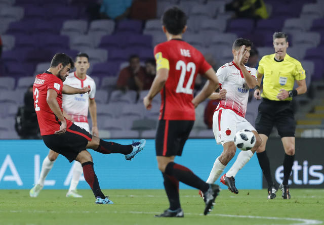Japan's Urawa Reds Mauricio Antonio, left, scores the opening goal during the Club World Cup soccer match for the fifth place between Wydad Athletic Club and Urawa Reds at the Hazza Bin Zayed stadium in Al Ain, United Arab Emirates, Tuesday, Dec. 12, 2017. (AP Photo/Hassan Ammar)