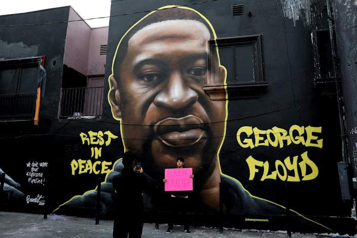 Artists memorialized George Floyd with murals and street art in the Melrose Avenue area.