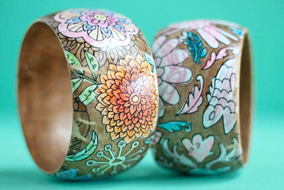 """<p>Take a page (literally) from your kid's coloring book to create these beautiful bangles.</p><p><strong>Get the tutorial at <a href=""""https://persialou.com/diy-coloring-page-bracelets-for-mothers-day/"""" rel=""""nofollow noopener"""" target=""""_blank"""" data-ylk=""""slk:Persia Love"""" class=""""link rapid-noclick-resp"""">Persia Love</a>.</strong></p><p><strong>What you'll need: </strong><em>wood bangles ($9, <a href=""""https://www.amazon.com/MonkeyJack-Natural-Unfinished-Wooden-Bracelet/dp/B0744KWSDW"""" rel=""""nofollow noopener"""" target=""""_blank"""" data-ylk=""""slk:amazon.com"""" class=""""link rapid-noclick-resp"""">amazon.com</a>)</em></p>"""